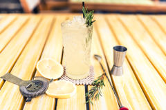 Alcoholic lemonade  drink with gin tonic, lime, rosemary and ice served cold at local pub, bar or restaurant. Royalty Free Stock Photography