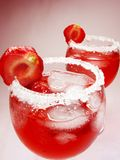 Alcoholic liqueur punch cocktails with cherry Royalty Free Stock Images