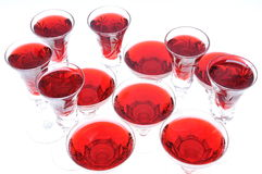 Alcoholic liquors in the crystal glasses Stock Image