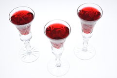 Alcoholic liquors in the glasses Stock Images