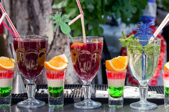 Alcoholic liquors and soft refreshments drinks by the glass on the bar outdoors. Royalty Free Stock Image