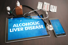 Alcoholic liver disease (liver disease) diagnosis medical. Concept on tablet screen with stethoscope stock photo