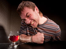Alcoholic locked to glass of alcohol Royalty Free Stock Photo