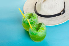 Alcoholic mojito and hat Stock Images