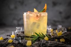 Alcoholic or non-alcoholic cocktail with lemon citrus and ginger with added liqueur, vodka, champagne or martini. Cool drink. Easy Bartenders Recipes and Ideas stock image