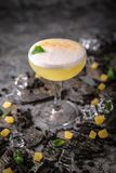 Alcoholic or non-alcoholic cocktail with lemon citrus and ginger with added liqueur, vodka, champagne or martini. Cool drink. Easy Bartenders Recipes and Ideas stock photography