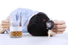 Alcoholic offering a car key Stock Images
