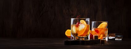 Free Alcoholic Old Fashioned Cocktail With Orange Slice, Cherry And Orange Peel Garnish Stock Photo - 174332190