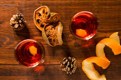 Alcoholic punch drink, dried orange fruit and pine cone Stock Photos