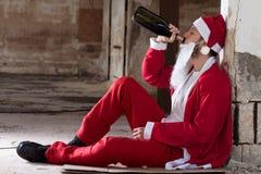 Alcoholic Santa stock images