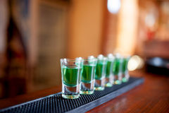 Alcoholic shots of different drinks at a party Royalty Free Stock Photography