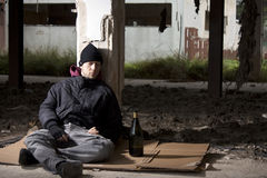 Alcoholic Sitting on the Floor Stock Images
