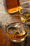 Alcoholic Whiskey Bourbon in a Glass with Ice royalty free stock image