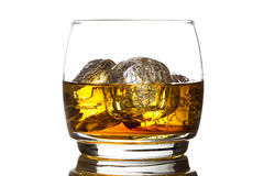 Alcoholic Whiskey Bourbon in a Glass with Ice stock images