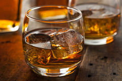 Alcoholic Whiskey Bourbon in a Glass with Ice Stock Photos