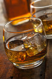 Alcoholic Whiskey Bourbon in a Glass with Ice Royalty Free Stock Photo