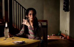 Alcoholic woman Stock Image