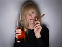 Alcoholic Woman with Cigar and Whiskey Stock Image
