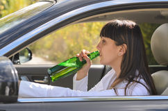 Alcoholic woman drinking a driving Stock Photography