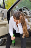 Alcoholic woman driver stopping for a drink Royalty Free Stock Image