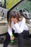Alcoholic woman driver stopping for a drink Stock Photos