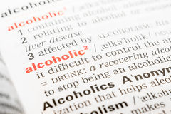 Alcoholic Word Definition. In Dictionary Close Up royalty free stock image