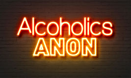 Alcoholics anon neon sign on brick wall background. Alcoholics anon neon sign on brick wall background royalty free stock photography