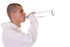 Alcoholism. Guy drinking a bottle of vermouth Royalty Free Stock Images