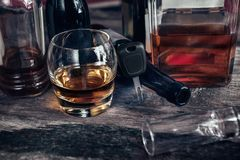 Alcoholism and driving concept. With car keys and alcohol drink Stock Photos