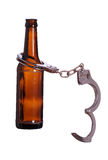 Alcoholism with handcuff. On white royalty free stock photo