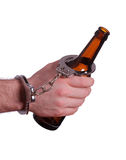 Alcoholism with handcuff and bottle. On white royalty free stock photos