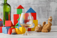 Alcoholism issue. Broken Toy Blocks City, Baby House Building Br Stock Photos