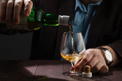 Alcoholism issue, drinking after hard work Royalty Free Stock Images