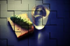 Alcoholism. social problems loneliness. glass of vodka bread and. Pickle on a dark background. a picture falling to pieces. double vision strong intoxication royalty free illustration