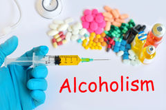 Alcoholism. Syringe with drugs for alcoholism treatment royalty free stock photos