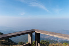 Alcony with mountain landscape at Chiang Mai, Thailand. Copy Space. Wood balcony with mountain landscape view at viewpoint of Kio Mae Pan, Chiang Mai, Thailand Royalty Free Stock Photography