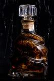 Alcool in una bottiglia Immagine Stock