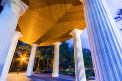 Alcove with white columns. In evening park, Riga royalty free stock images