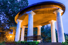 Alcove with white columns. In evening park, Riga stock photo