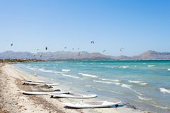 Alcudia, Mallorca - Kitesurfing at the beautiful beach of Alcudi. Alcudia, Mallorca, Spain - Kitesurfing at the beautiful beach of Alcudia Royalty Free Stock Image