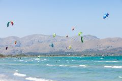 Alcudia, Mallorca - A sky full of kites at the farsighted beach. Alcudia, Mallorca, Spain - A sky full of kites at the farsighted beach of Alcudia Stock Photos