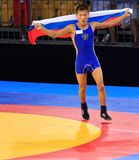 Aldar Balzhinimaev. Singapore - Aug. 17: Intl Con Centre. Aldar Baizhinimaev celebratory jog holding Russian flag  after winning the gold medal on Aug. 17, 2010 Stock Image