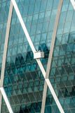 Aldar building with window cleaners Stock Photo