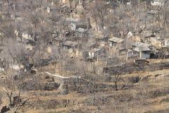 Aldea-casas abandonadas Foto de archivo libre de regalías