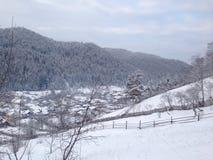 Aldea en invierno Fotos de archivo libres de regalías