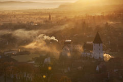 Aldea en salida del sol Fotos de archivo libres de regalías