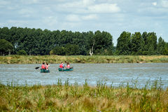 ALDEBURGH, SUFFOLK/UK - JULY 31 : People Canoeing on the River A Royalty Free Stock Photo