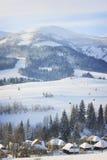 Aldeia da montanha do inverno Foto de Stock Royalty Free