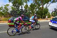Aldemay Ortega, Team Manzana Postobon And Lorrenzo Manzin, Team FDJ. The riders amongst the team cars during stage 9 of La Vuelta Espana 2017 Stock Photos