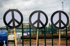 Protesters gather outside the main gate to the AWE, Aldermaston. Aldermaston, United Kingdom, 1st April 2018:- CND protesters gather outside the main gate to the royalty free stock photography
